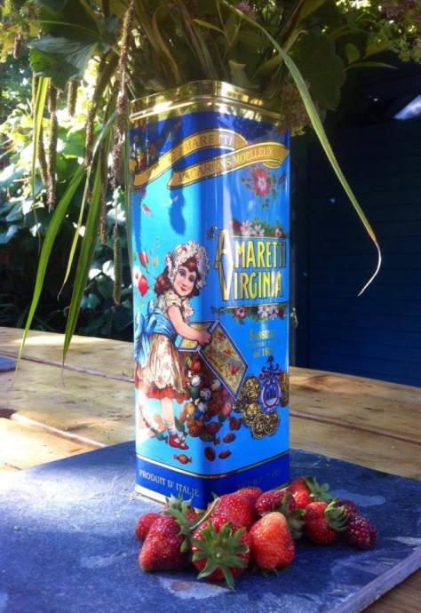 Vintage tins make great vases. And collecting strawberries from your own garden is a true treat.