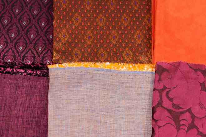 It's not just about being brave with pattern; be adventurous with texture too. Here we can see orange suede, shot silk, damask and hand-woven material I brought back from Cambodia all working beautifully together. The colour palette is fairly constrained, but the juxtaposition of textures is what brings the excitement. (photo by Chris Gatcum)