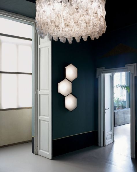 A 1961 oversize Venini chandelier and vintage Stilnovo hexagonal wall lights dominate the entryway. A Fine Balance - T Magazine (nytimes.com)