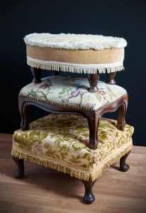 A tower of foot stools. What the foot stool looked like originally.