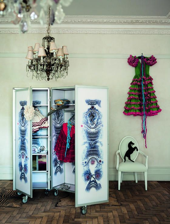 And why not hang clothes on the wall. (desiretoinspire.net)