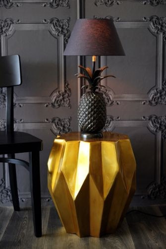 Pineapple lamp on old gold carambola side table. (rockettstgeorge.co.uk)