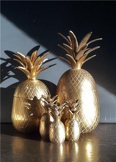 Vintage mid century brass pineapples. (tumblr.com)