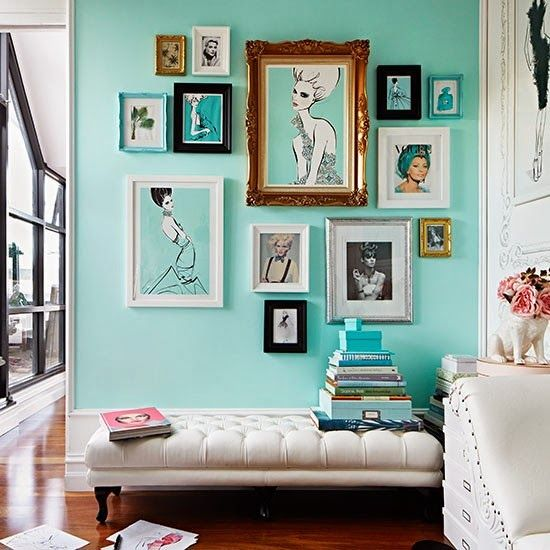 Create gallery walls with groups of artwork. Here the different-sized pictures hang together beautifully on the solid-coloured background wall. (dailydreamdecor.com)