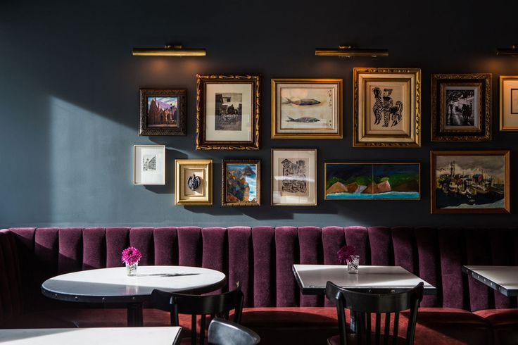 Dark walls and aubergine velvet upholstery, together with a gallery wall work beautifully to create an intimate corner. The Palladian Hotel in Seattle. (lonny.com)